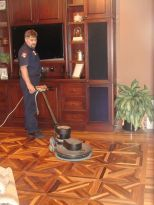 Picture of technician cleaning wood floor